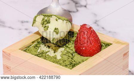 Matcha Tiramisu With A Strawberry On Top In The Japanese Masu Wooden Sake Cup.