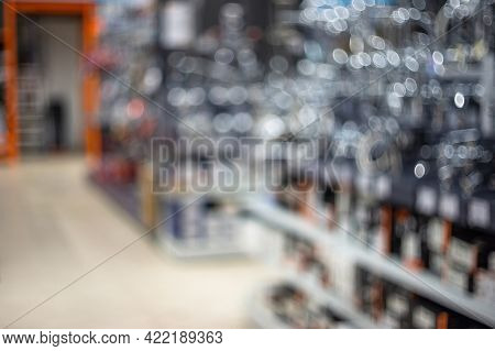 Abstract Blurred Shelving With Tools In Retail Store In Mall For Background