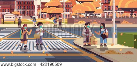 Mix Race Schoolchildren In Masks Crossing Road On Crosswalk Pupils Walking To School Coronavirus Pan