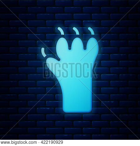 Glowing Neon Paw Print Icon Isolated On Brick Wall Background. Dog Or Cat Paw Print. Animal Track. V