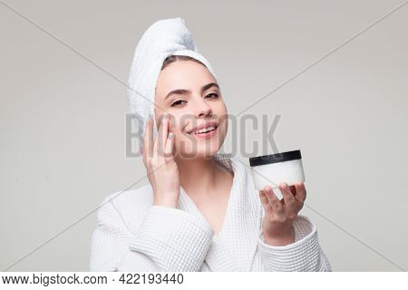 Young Woman Uses Body And Face Care Cream.