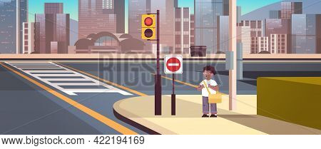 African American Schoolboy With Backpack Standing On City Street Near Red Stop Road Sign Road Safety
