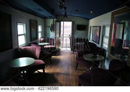 May 26, 2021 San Juan Capastrano, California: Inside an antique Train Rail Car showing the luxury of travel fron the 1800's. Editorial.