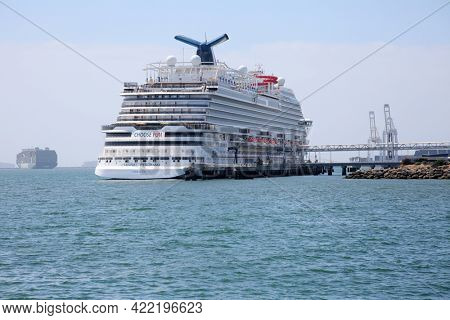 May 19, 2020 Long Beach, California. USA:  A Cruise Ship docks while in Long Beach California. A Cruise ship is cleaned, loaded prepared to be loaded with happy vacationers. Editorial.