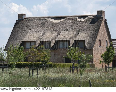 Sint Gillis Waas, Belgium, May 29, 2021, House With A Damaged Thatched Roof