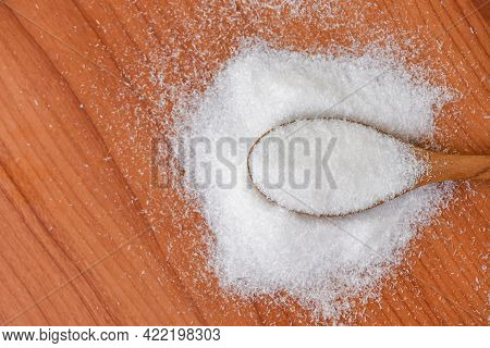 Msg For Food Seasoning, Monosodium Glutamate On Spoon And Wooden Table Background