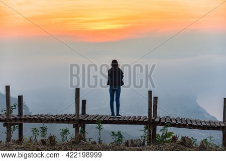 Woman Standing On A Wooden Bridge And Looking View Nature River And Sunrise Or Sunset, Landscape Wom