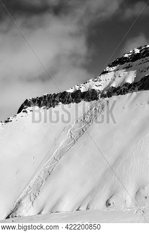 Off-piste Slope With Traces Of Skis, Snowboards And Avalanches. Caucasus Mountains In Sun Winter Day