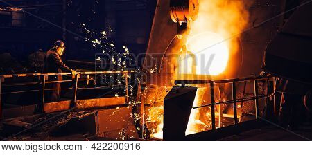 Molten Metal Pouring From Blast Furnace In Foundry. Iron Casting Process In Steel Mill, Metallurgica