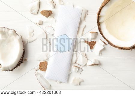 Scented Sachet And Coconut On White Wooden Table, Flat Lay