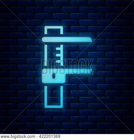 Glowing Neon Calliper Or Caliper And Scale Icon Isolated On Brick Wall Background. Precision Measuri