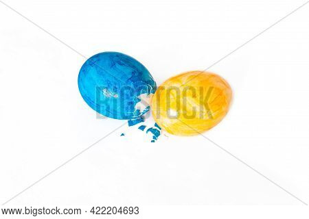 Eggs Peck With Blue And Yellow Easter Eggs And White Background