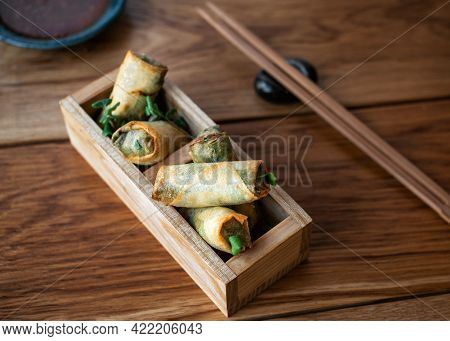 Chinese Spring Rolls With Sweet Sauce. Fried Vietnamese Spring Rolls With Sweet Chili Sauce. Asian A