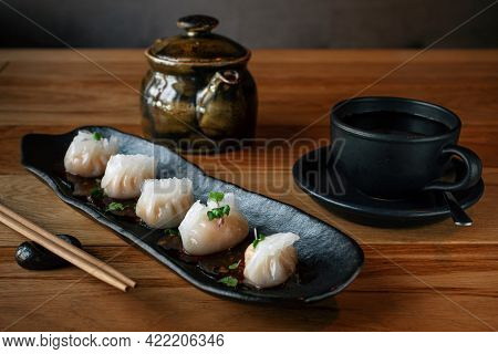 Chinese Traditional Dumplings. Dimsum With Seafood And A Cup Of Tea. Traditional Asian Cuisine, Chin