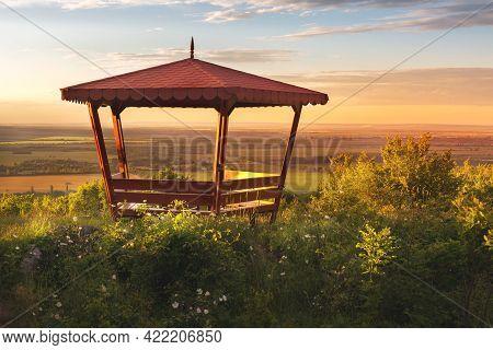 Outdoor Wooden Gazebo Over Summer Sunset Landscape Background, Green Valley, North Bulgaria