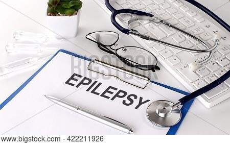Epilepsy Text On White Paper On The White Background. Stethoscope ,glasses And Keyboard