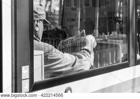 Germany, Munich, March 25, 2017, Older Turk Man Is Reading A Turkish Newspaper Called Hafta Sonu In