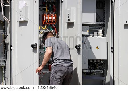 Electrician Engineer Working On The Electrical Distribution Board. Repair Works, Street Lighting Sys