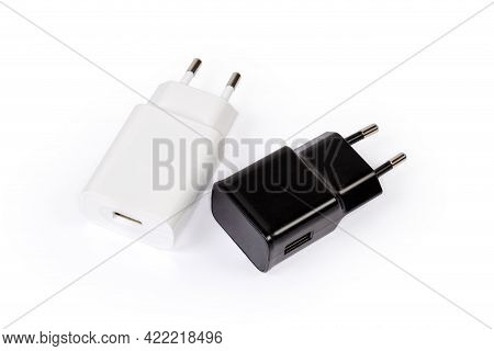 Two Different Ac Adaptors With Output Usb Ports And Ac Europlugs For Batteries Charging  Of Mobile D
