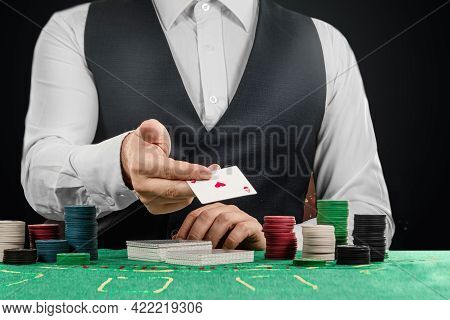 Male Croupier In The Casino At The Table Hands Close-up. Casino Concept, Gambling, Poker, Chips On T