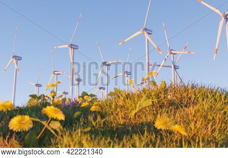 Wind Power Station With Grass And Flowers In Foreground Out Of Focus And Clear Sky. 3d Render