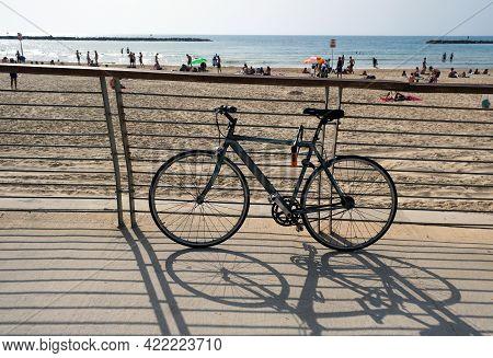Tel-aviv, Israel - May 03, 2021: The Bike Stands On The Embankment Of Tel Aviv Against The Backdrop