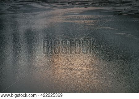 Texture Of Golden Calm Water Of Lake In Sunrise. Meditative Ripples On Water Surface. Nature Minimal