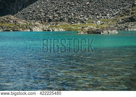 Beautiful Landscape With Turquoise Mountain Lake. Azure Glacial Lake In Sunlight. Colorful Sunny Sce