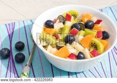 In A White Earthenware Bowl, Fruit Fresh Vitamin Salad For A Healthy Diet.