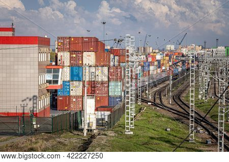 Railway Container Terminal In Moscow. Rows Of Colorful Stacked Cargo Containers Waiting For Loading