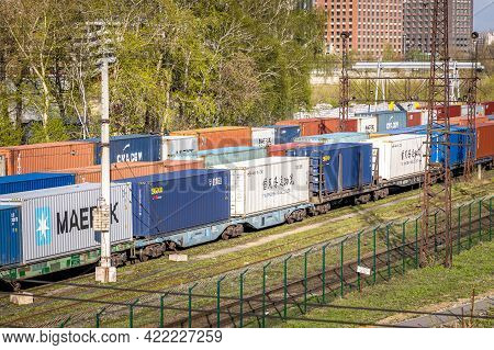 Freight Train With Cargo Containers Maersk, Cma Cgm, Saeco And Other Carriers. International Contain