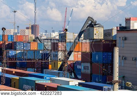 A Container Loader Lifts The Cargo Container To The Top Of The Stack. Logistic Railway Terminal In M