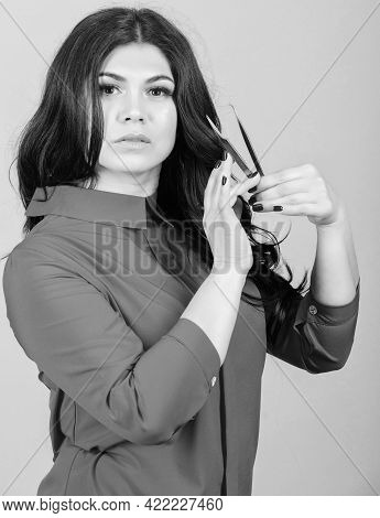 Tweezing Her Eyebrow. Cosmetologist With Special Tool For Eyebrows. Pretty Woman Eyelash Master Hold
