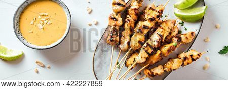 Chicken Grilled Satay Skewers Served With Lime And Peanut Sauce, Banner. Asian Thai Style Food.