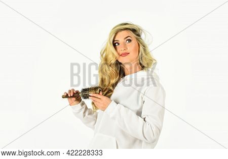 Beauty Comes From The Inside Woman With Long Blonde Wavy Hair Brushing It. Fashion Photo Of Beautifu