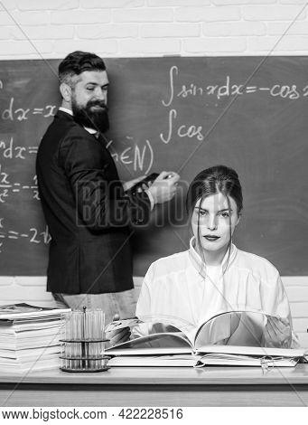 Good Teacher And Good Education Has No Substitute. Pretty Woman Teacher Teach Man Student In Class.