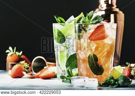 Summer Mojito Cocktail Or Mocktail Set With Lime, Mint, Strawberry And Ice In Glass On Black Backgro