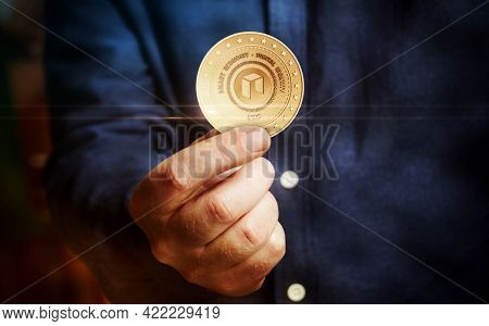 Neo Altcoin Cryptocurrency Symbol Golden Coin In Hand Abstract Concept.