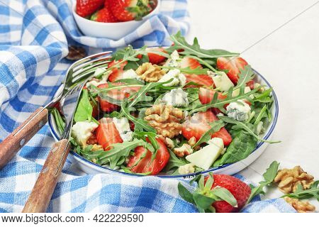 Strawberry Salad With Spinach, Arugula, Walnuts, Blue Cheese On Gray Table. Healthy Food. Top View