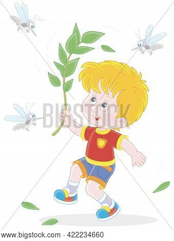 Cheerful Little Boy Jumping, Dispersing With A Branch And Brushing Off Small Angry Mosquitoes Flying