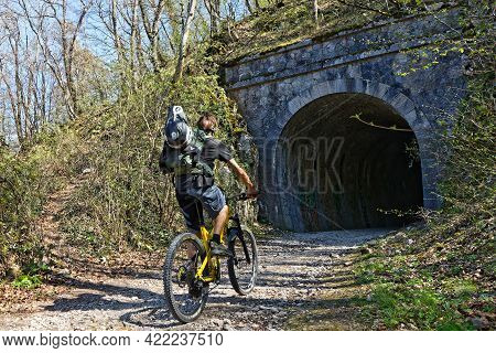 Grenoble, France, April 23, 2021 : Cycling On The Slopes Of Vercors, On An Old Abandoned Railway Tra