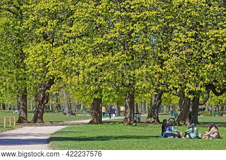 Lyon, France, April 8, 2021 : Lyon People Have A Rest In The Park On A Sunny Spring Day. The Park Is