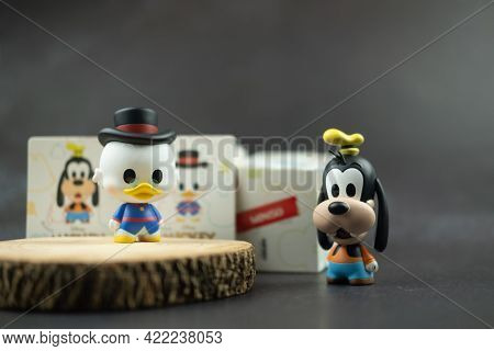 Samut Prakan, Thailand - May 31, 2021 : Cute Figurine Goofy And Scrooge Mcduck (mickey Mouse Family