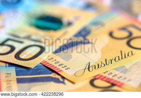 Australian money background, defocussed.  Fifty dollar notes.