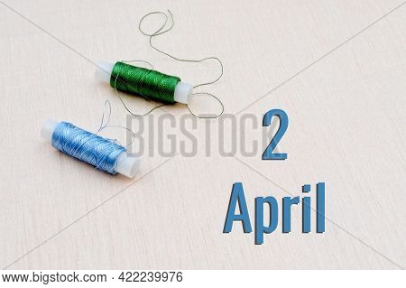 Handicraft Calendar 2 April. Skeins Of Green And Blue Threads For Embroidery On Beige Background. Ha
