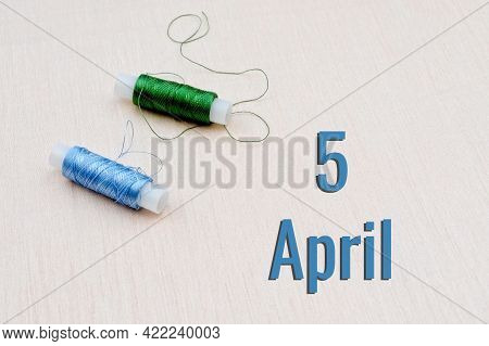 Handicraft Calendar 5 April. Skeins Of Green And Blue Threads For Embroidery On Beige Background. Ha