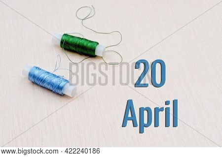 Handicraft Calendar 20 April. Skeins Of Green And Blue Threads For Embroidery On A Beige Background.