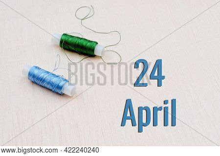Handicraft Calendar 24 April. Skeins Of Green And Blue Threads For Embroidery On A Beige Background.