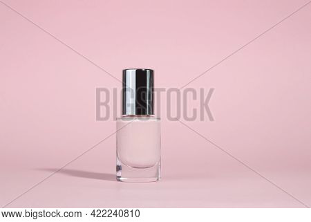 Manicure Varnish Or Gel Varnish Of A Beige Shade Isolated On A Beige Background. The Concept Of Nail