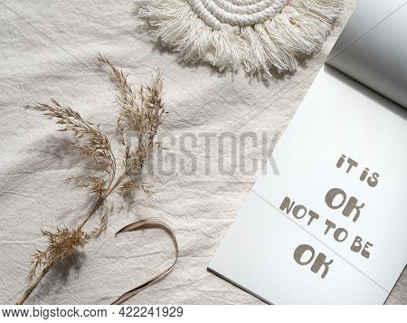 Text Its Ok Not To Be Ok In Block Note. Envelope, Macrame, Pampas Grass.. Simple Minimal Flat Lay On